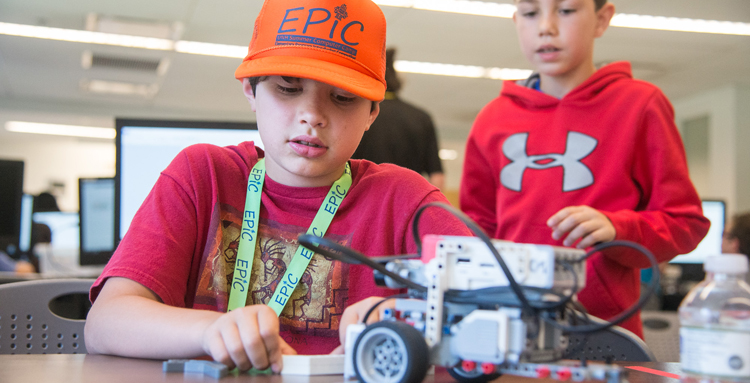 Boy working on robotic car at UNH EPIC Camp