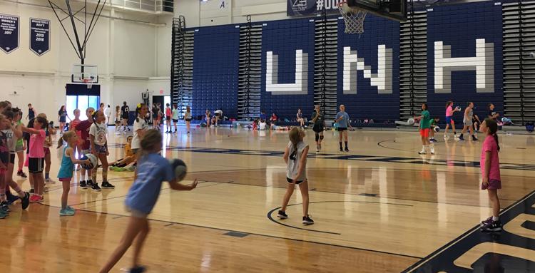 Girl driving to basket at UNH Basketball Camp