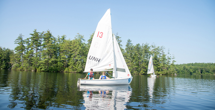 Large white sailboat on Mendums Pond from UNH Sailing camp