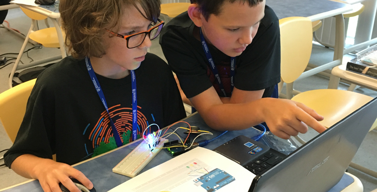 Students at UNH Tech Camp doing computer programming