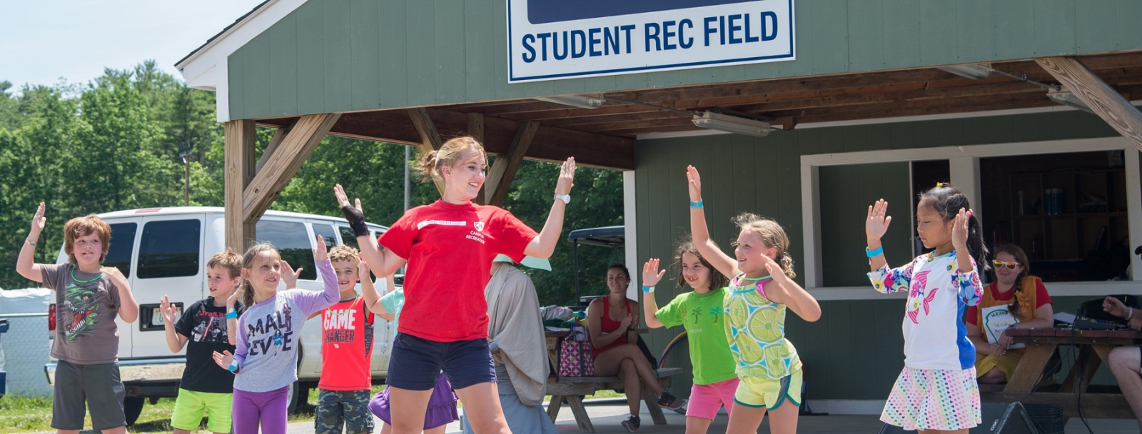 Camp Wildcat students dancing led by staff member